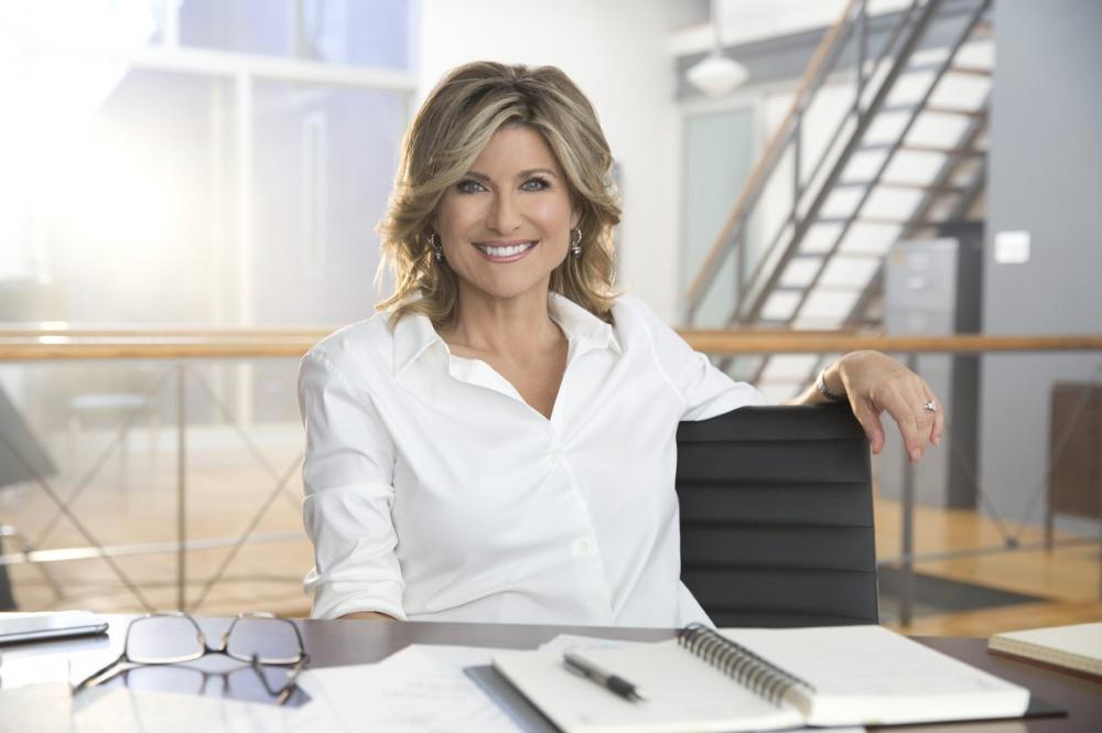 A woman at a desk smiling